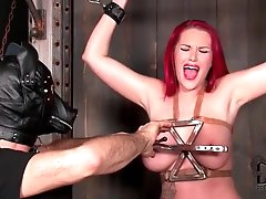 Busty redhead enjoys the tit torture..