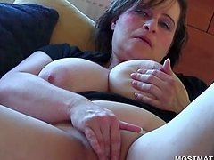 Close-up with busty mature rubbing her..