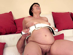 Brunette granny Margo T. gets her meaty snatch drilled near a pool