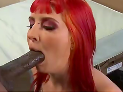 Tattooed Redhead Takes On Huge-Ass Black Cock