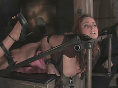 Over the top bondage scene with..