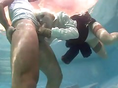 Blonde chick sucks hard dick underwater