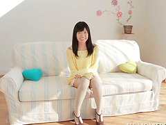 Petite Kana Aono undresses and fondles..