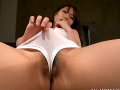 Sexy Japanese girl in a swimsuit masturbates on an armchair
