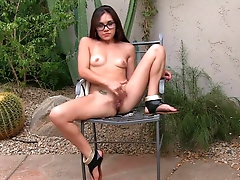 Spicy brunette in cute glasses is..