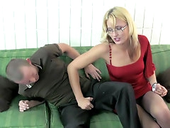 Milf in glasses gives a nice handjob