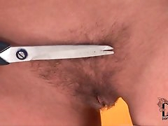 Skinny girl trims pubic hair with..