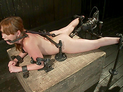 Redhead gets her nipples yanked while..