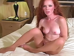 Curly redhead poses in her nice nylons