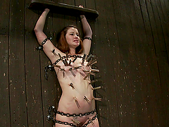 Mr. Torture gives pain with his whips..