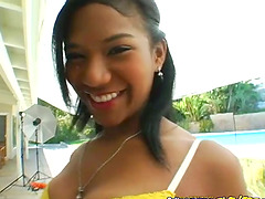 Ebony teen Emy Reyes smiles with cum..