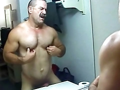 Muscular gay takes off his police..
