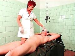 Mature nurse in gloves fingers his..