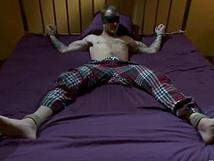 Ball gagged and blindfolded dude is..