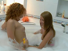 Two horny lesbian hotties having fun..