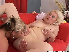 Two mature lesbians lick each other's..