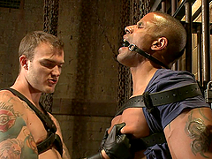 Sexy gay hunks have fun in a bondage..
