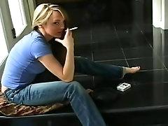 Solo girl has cigarette while..