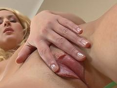 Blonde babe masturbates her pink pussy