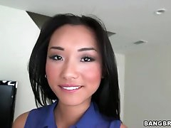 Young Asian Alina Li in sexy striptease