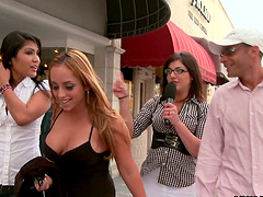 Crazy girls give a blowjob right in a..