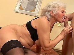 Horny Grandma Fucks a Younger Guy In a..