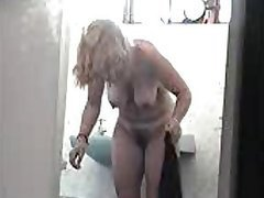 Voyeur Spy Cam Catches a Busty Mature..