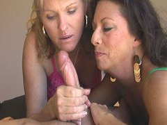 Two Horny Mature Jerking Off a Cock in..