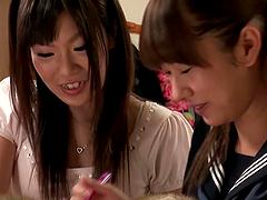 Two Japanese lesbians enjoy licking..