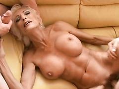 Hot Blonde MILF Milking Two Cocks