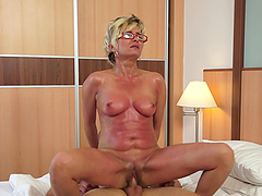 Mature lady is riding her sex victim..
