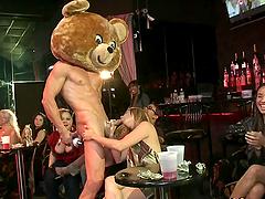 Bunch Of Gals Sucking A Stripper's Big..
