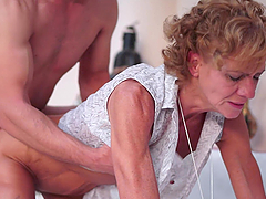 Granny makes out with a horny stud..