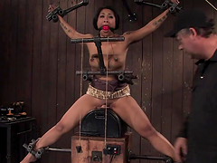 Exotic tattooed girl with natural tits rides sybian in bondage session