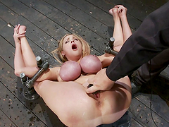 Bondage and toying fun with busty..