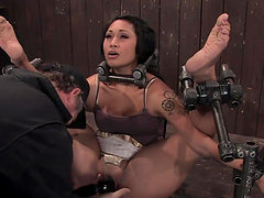 Exotic girl in exposed position getting toyed with vibrator in BDSM
