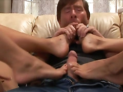 Two blondes are giving a hot footjob..