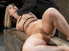 Cute blonde in hot bondage scene