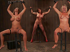 Busty sex slaves in kinky bondage scene