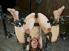 Intense bondage scene with redhead slave