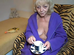 Old lady masturbates after having cup..