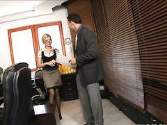 Sexy blonde Donna Bell office..