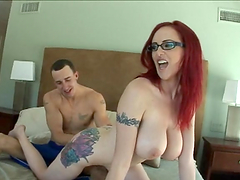 Tattooed redhead with glasses gets..