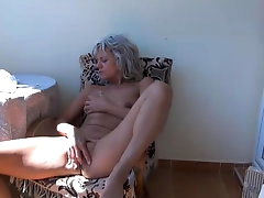 Blonde granny is touching her vagina
