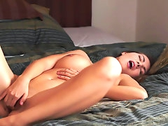 Busty chick Connie Carter pokes her..