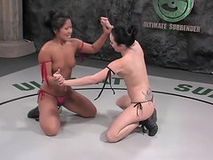 Two babes wrestle and have sex in the..