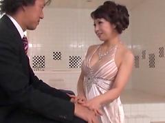 Japanese MILF in an evening dress gets..
