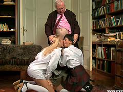 Two nasty students give a blowjob to..