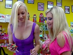 Three babes with nice asses and tits toy pussies with a strap-on