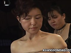 Asian babe in rope bondage scene